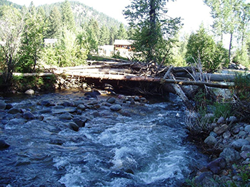 Debris jam on Flint Creek has been removed and threat to bridge downstream is eliminated.