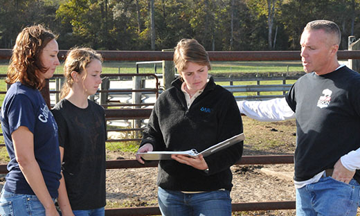 Delaware NRCS soil conservationist works with local farmer to discuss conservation options.