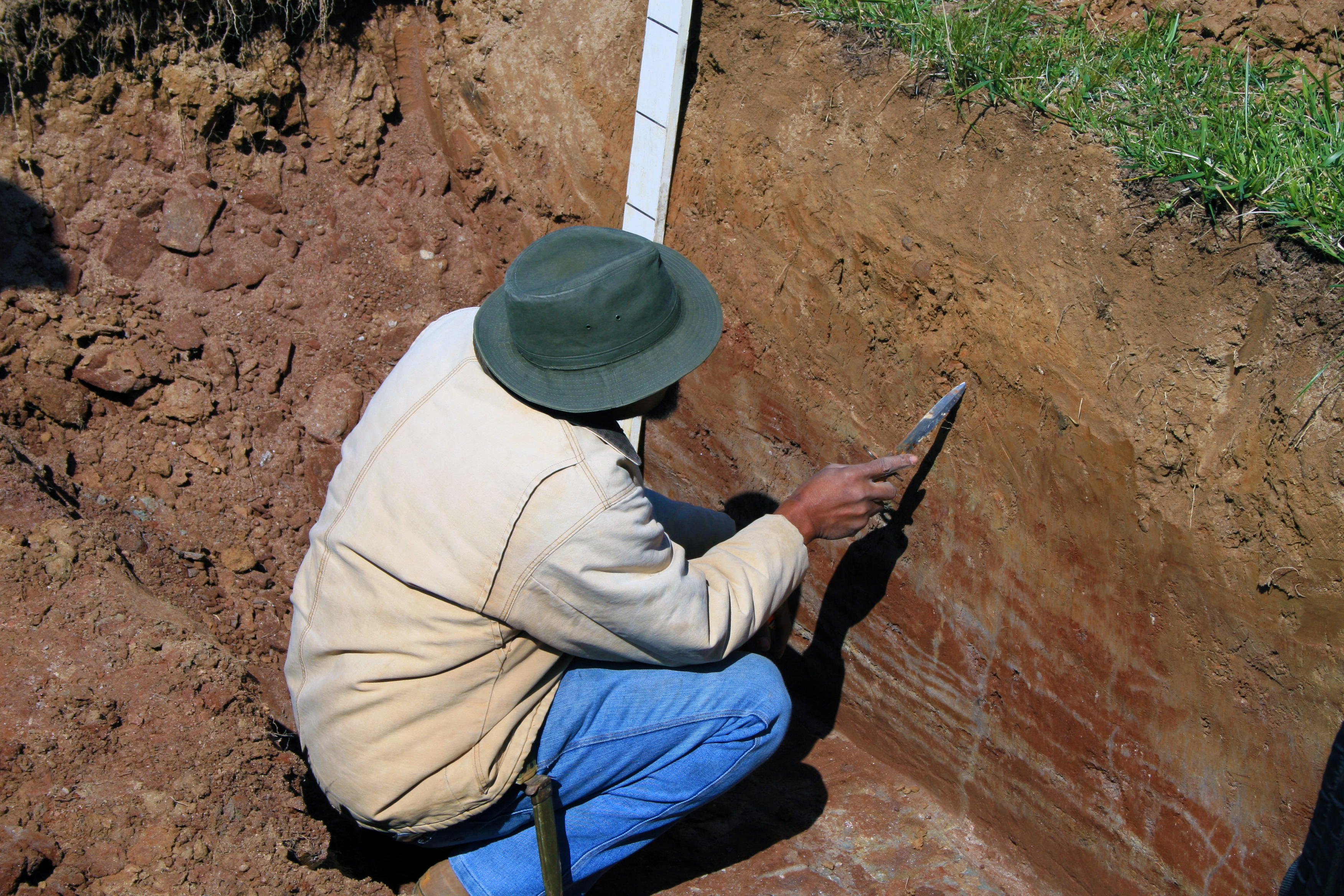 Soil Survey photo (man with hat and equipment