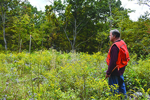 Wisconsin Technical Service Provider John Nielsen standing in understory forest.