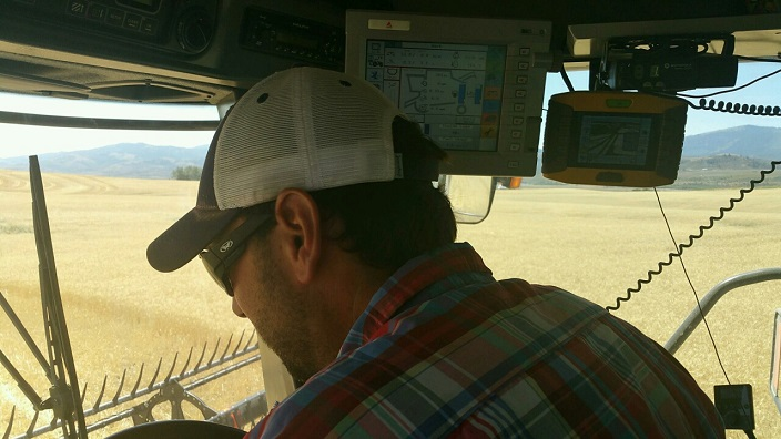 Dan Lakey, a third generation farmer in Soda Springs, works to bring in the harvest