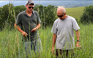 Bobby Drumheller (left) inspects a pasture with his father, Charlie, at Bellvue Farm in Augusta County