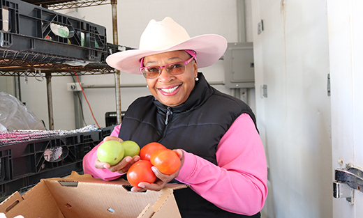 Dr. Ayers-Elliott harvested her tomatoes before the incoming of the wintry mix. The tomatoes ripened in her heating facility and are now ready for market.