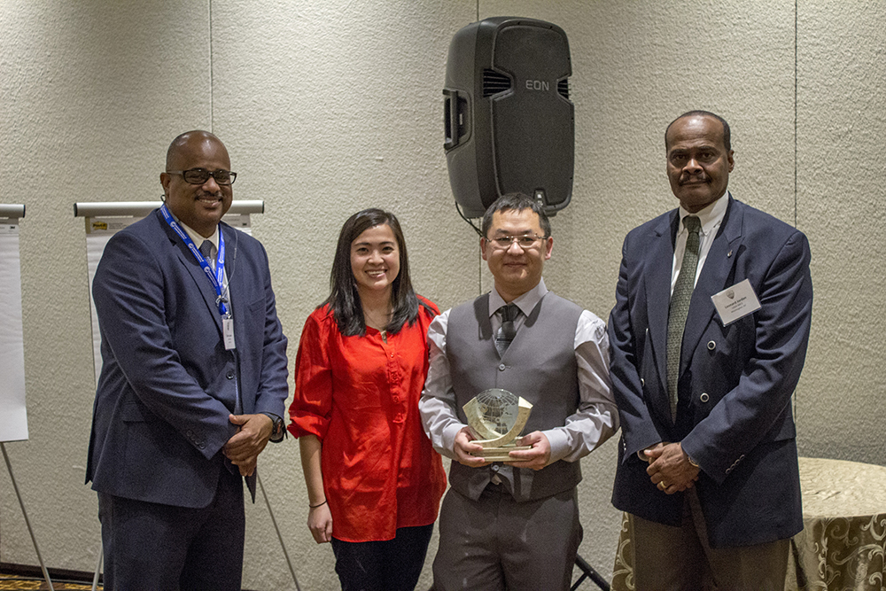 Left to Right: Carlos Suarez, California State Conservationist and Co-Chair of the National Civil Rights Advisory Committee to the Chief; Mai Yia Yang, recipients wife; KaYing Vang, award recipient; Leonard Jordan, acting NRCS Chief.