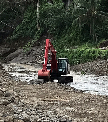 Heavy equipment begins clearing debris from Coamo River on December 11, 2017, with funding from the NRCS EWP program.
