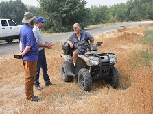 Jim Belthoff (left), a Boise State University professor specializing in raptors, discusses with landowner Wendell Holton how to space out artificial burrows for Burrowing Owls and nesting boxes for Barn Owls to reduce competition between the two species.