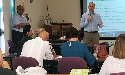 NRCS Caribbean Director Almodóvar discusses hurricane recovery progress with partners at June 20, 2018 State Technical Committee Meeting at USDA-IITF in San Juan.
