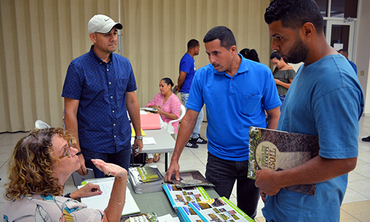 Mayaguez DC, Zulma Garcia (left), and Director Edwin Almodovar (2nd from left), explain available programs to Las Marias farmers on May 15, 2018.