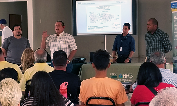 NRCS ASTC for Programs, Jose Castro; Corozal DC, Freddie Rivera; Corozal SC, Christian Vargas; and Corozal SCT, Abiud Mulero, interact with over 80 farmers at Orocovis meeting on May 18, 2018.