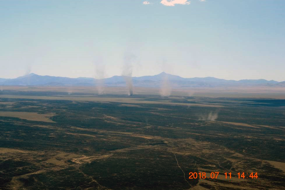 Dust devils, some of them rising hundreds of feet in elevation, observed from the air after the Martin Fire. Photo: Bruce Thompson, U.S. Bureau of Land Management