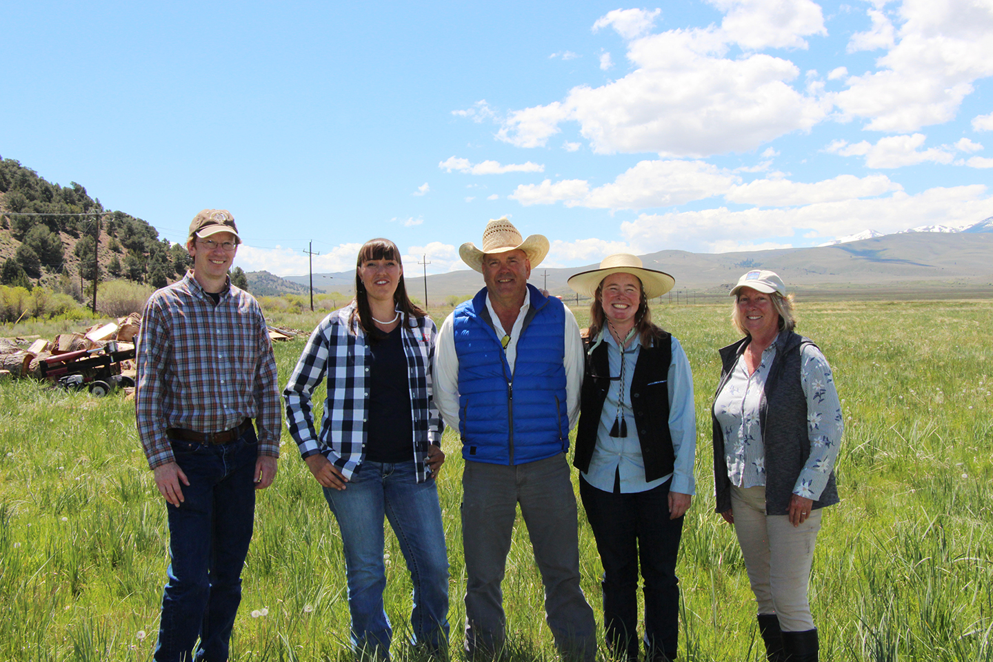 From l to r: NRCS Nevada's District Conservationist Jim Gifford, Soil Conservationist Jessica Gwerder, Sceirine Point Ranch's David Sceirine, and ESLT's Susanna Danner and Kay Ogden pose at the ranch to celebrate the newest conservation easement closure in the Bi-state sage-grouse area.