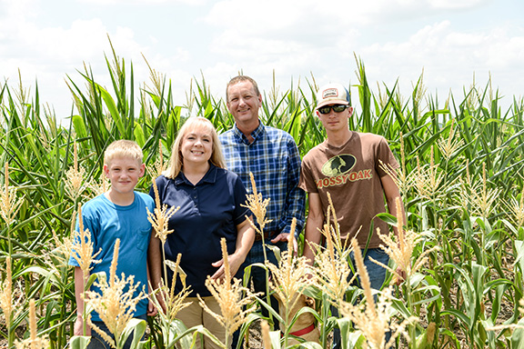 jpg  Rodney and Susan Schronk with sons Trey and Ryan are in the corn field on site of the Field to Fork dinner.