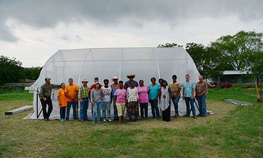 The volunteers worked all day to construct a 20x24' high tunnel on Kay and Virgil Bell's property