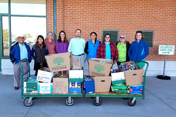 Rhode Island USDA staff with food donated to the RI Food Bank.