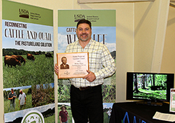 J.B. Daniel accepted the Harlan White Award at VFGC's recent Winter Forage Conference.
