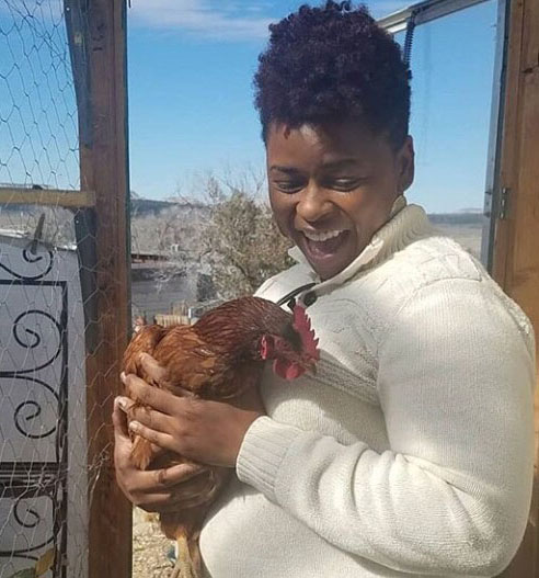 Photo of Jasmine Wilson, Soil Conservationist, Los Lunas Service Center, holding a rooster.