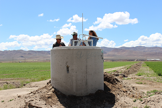 Yerington District Conservationist Angela Mushrush visits with producers at Moreda Dairy