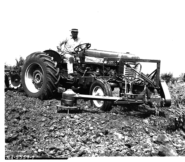 Image of a tractor mounted in-the-row tree cultivator