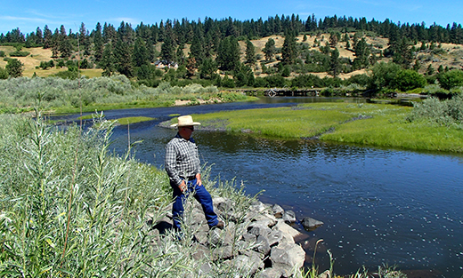 Mike Burton, District Conservationist, stands on the banks of the Grande Ronde River in Union County, Oregon.