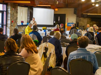 Donna Hepp (standing), Chairman of the Belknap County Conservation District (BCCCD) welcomes attendees to the N.H. Association of Conservation Districts' 2019 annual meeting at the lodge at the Gunstock Mountain Resort in Gilford, N.H. October 17, 2019.