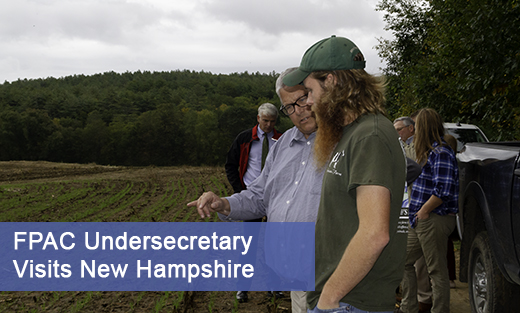 Si Robertson (right), nutrition and crop specialist at Contoocook Creamery shows the results that programs and technical assistance from NRCS achieved to Undersecretary for Farm Production and Conservation (FPAC) Bill Northey (middle) at Bohanan Farm in Contoocook, N.H. October 7, 2019.