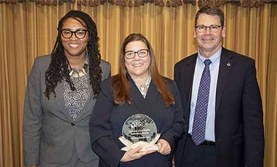 Melissa Sturdivant, center, is presented with Chief's Individual Civil Rights Award by Texas Acting State Conservationist Drenda Williams, left, and NRCS Chief Matthew Lohr.