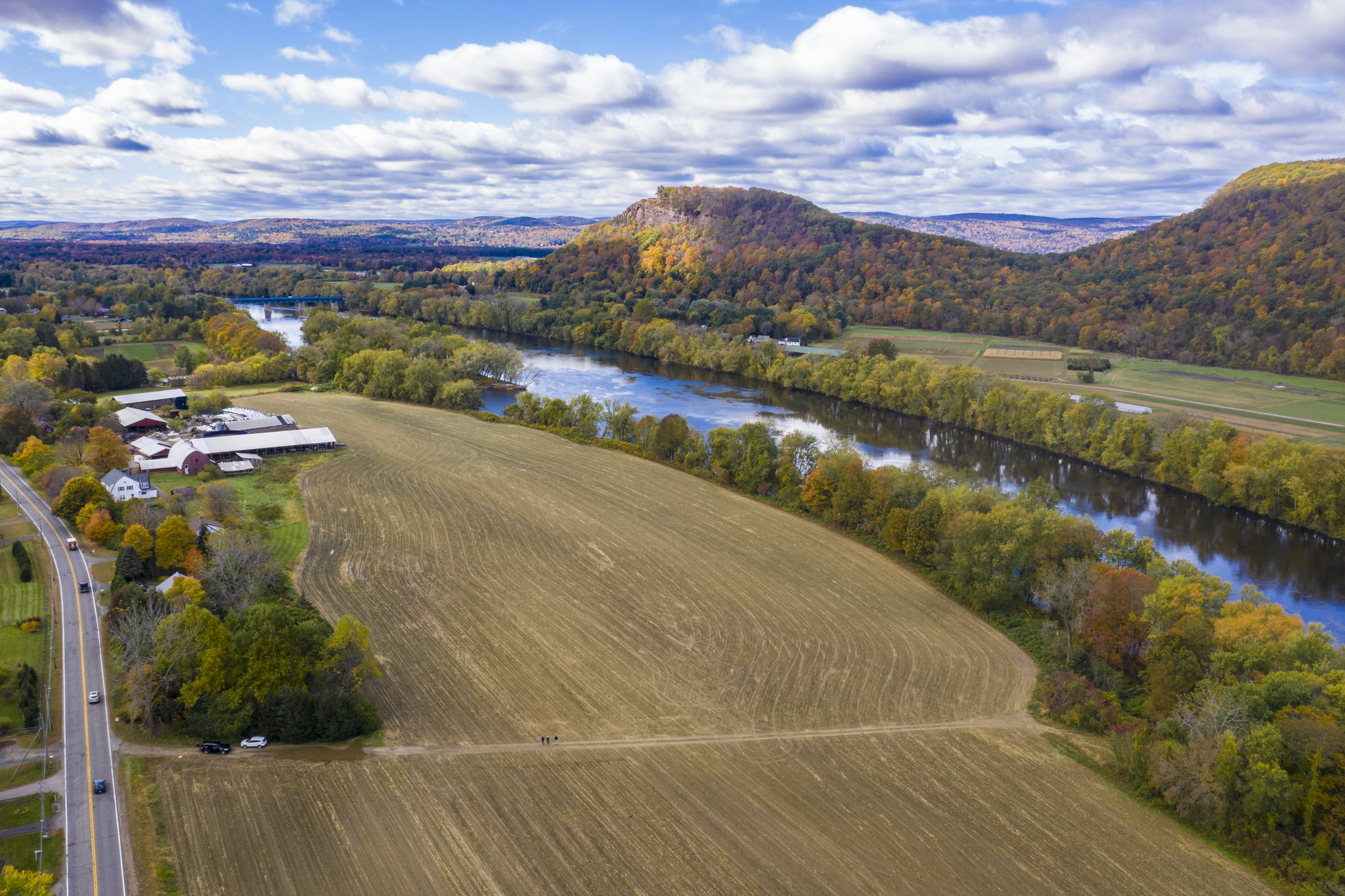 An aerial photo of a farm in Mount Toby Farm in Sunderland, Mass.in the autumn.