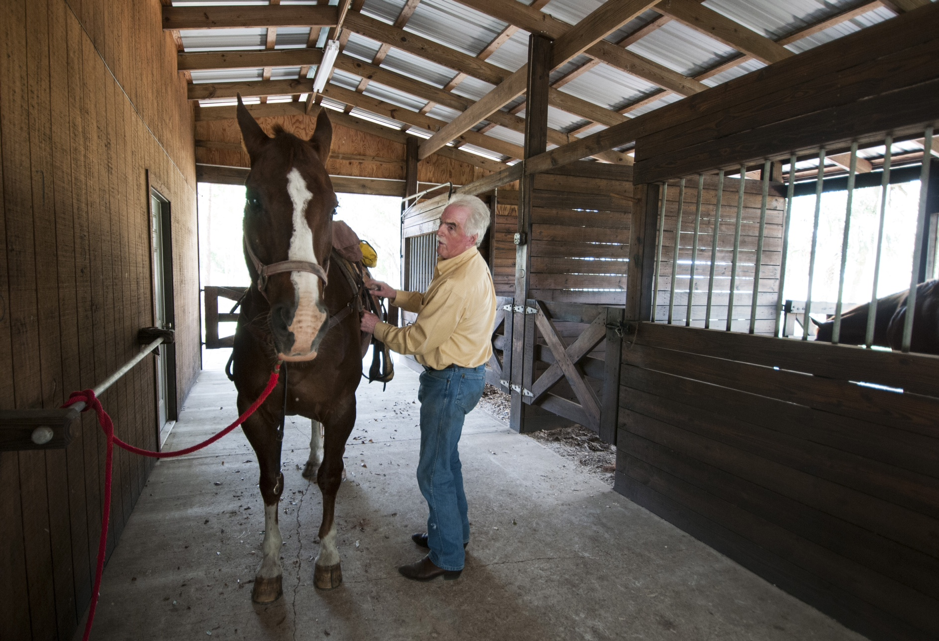 Dwayne House saddles up his horse on Goodno Ranch, where he is working with NRCS to enhance and prot