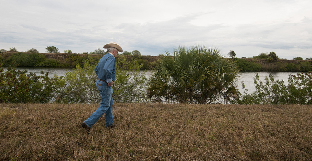 : Dwayne House walks along the Caloosahatchee River on his ranch where he has created a conservation