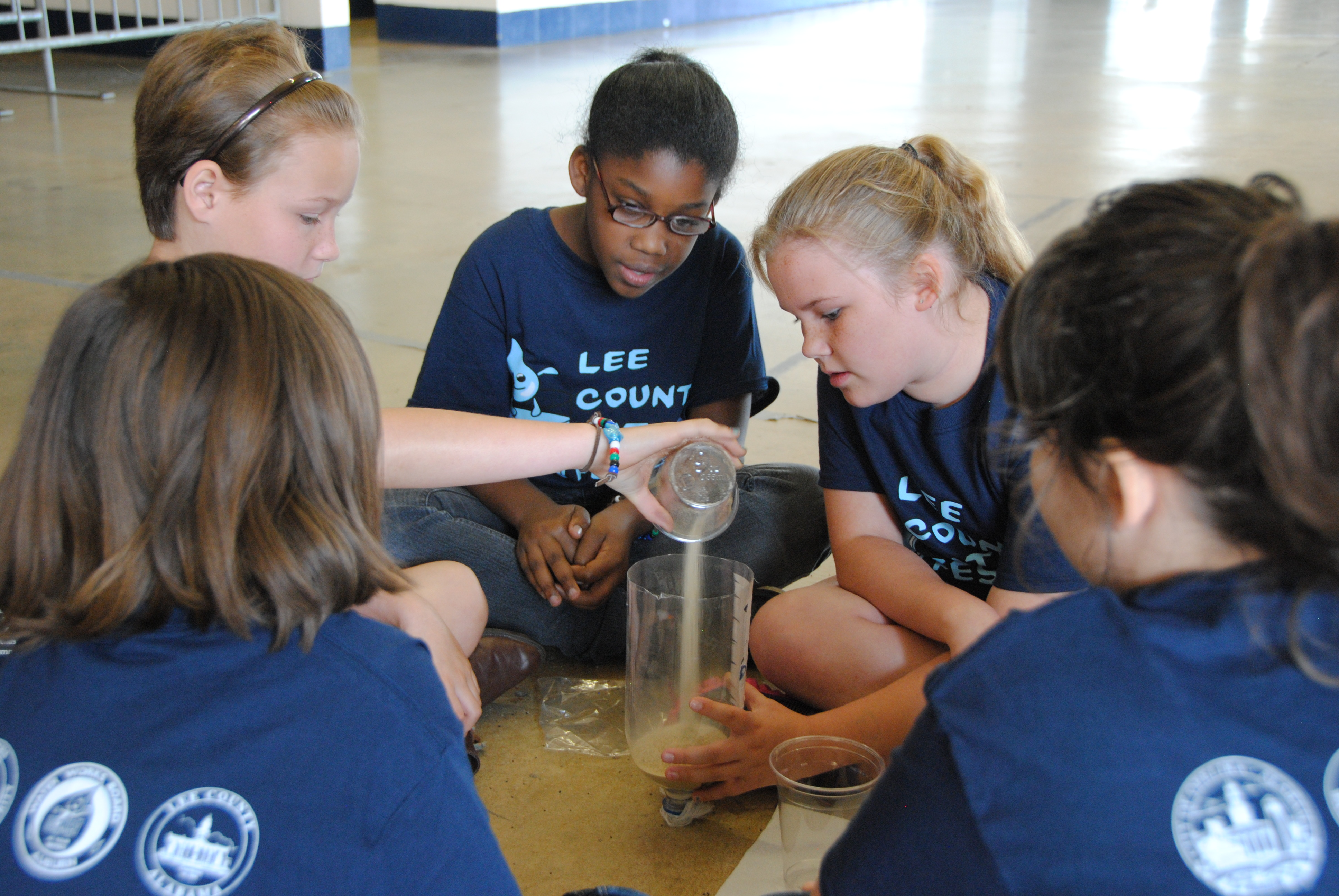 Students build a mini-filtration system.