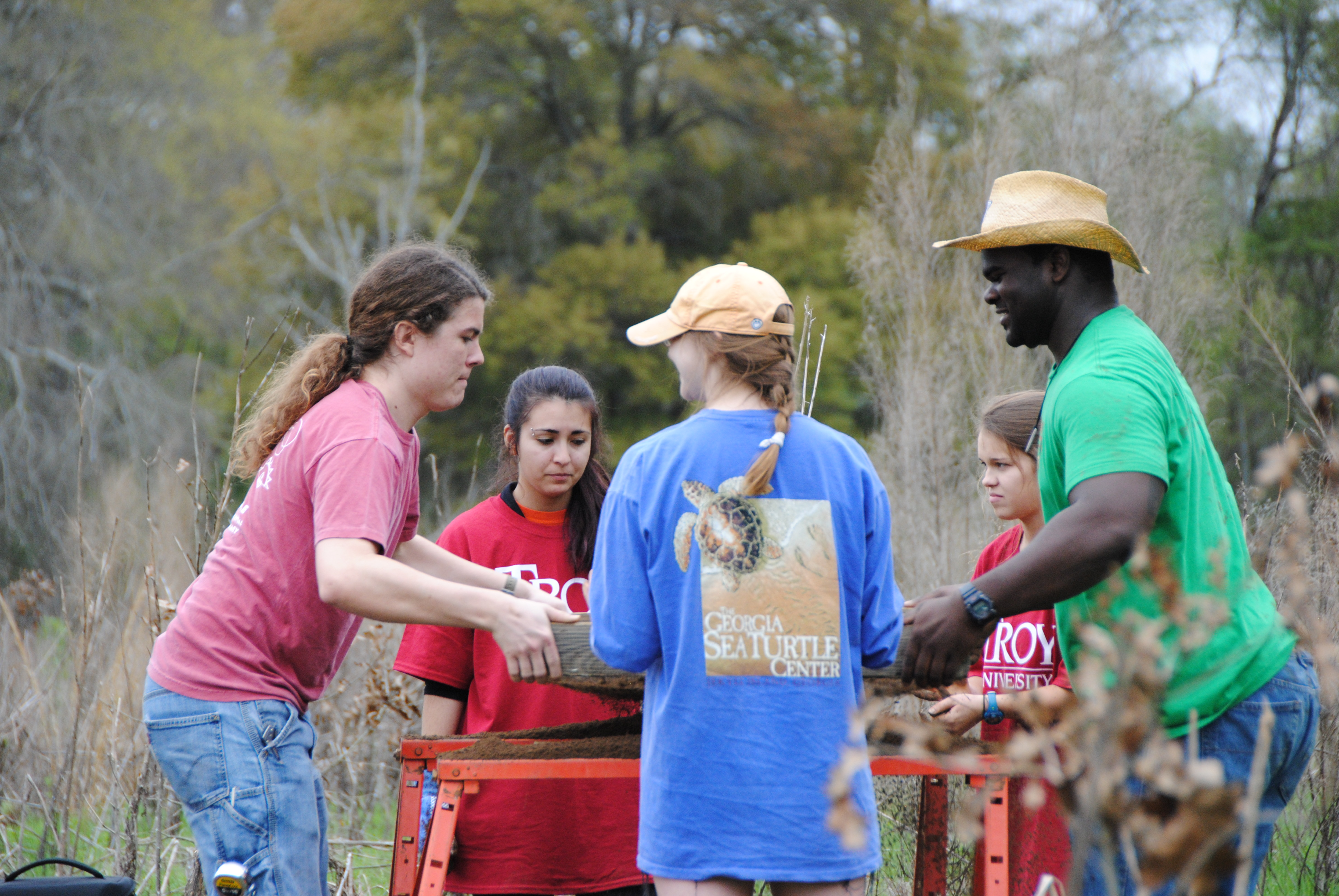 Teresa Paglione, NRCS Alabama's Cultural Resource Specialist (center) works on site with Troy Univer