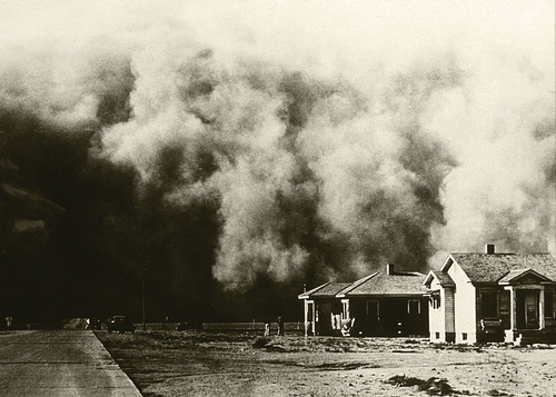 A huge dust storm moves across the land during the Dust Bowl of the 1930s.