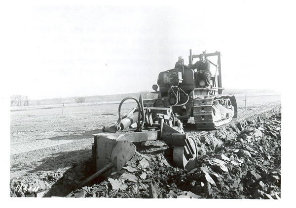 Deep plowing cropland following the \'51 flood.