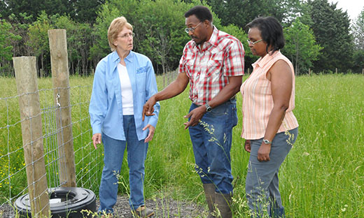 District Conservationist Marianne Hardesty works with Delaware farmer Norman and Gwen Pierce.