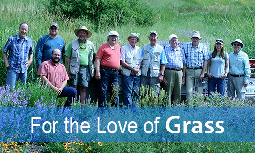 Retired PM Program leaders standing in a field of wildflowers and native grasses.