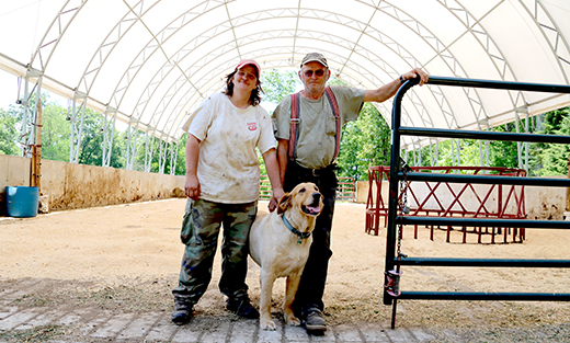 Lisa and Frank Kokoski stand inside their bedded pack facility at F&L Farms.