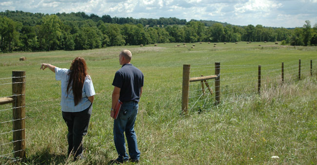 NRCS District Conservationist works with landowner