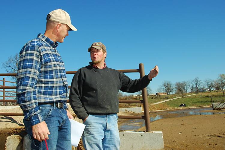 Nelson Hostetler (right) and NRCS engineer Michael Malone discuss the effectiveness of the new syste