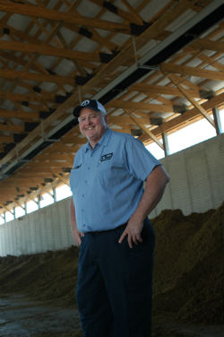 Farmer Dan Andreas standing in his barn.