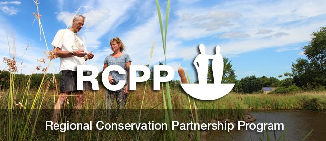 Regional Conservation Partnership Program banner - farmer and Soil Con in field