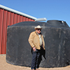 The ag water harvesting catchment system on Durham's ranch includes six 5,000 gallon storage tanks.