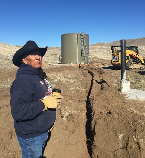 Randy Leo Teton, range technician for the Shoshone Bannock Tribe shows of the solar powered stock water system.
