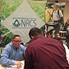 Doug Rose, retired marine, works with soldier on career opportunities with the NRCS and USDA.
