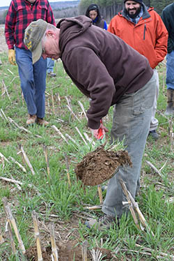 Dairy farmer Bob Fogler digs up a patch rich soil to look for worms during a Spring Cover Crop Walk on his farm in Exeter, Maine, April 26, 2016. Photo by Thomas Kielbasa