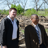 Hanlin and TPWD Director Rodney Franklin survey damage at Mother Neff State Park