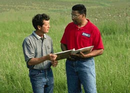 An NRCS employee helps a landowner with conservation planning.