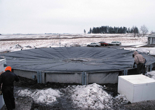 Round manure storage tank with flexible cover, designed to catch methane gas.