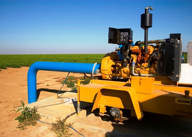 Bright yellow irrigation pump