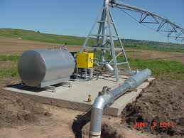 New, modern irrigation pumping plant with tank, sitting on concrete pad.