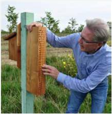 Craig McNamara inspects recently installed conservation practices